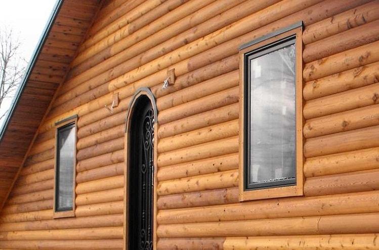 Облицока фасада дома блокхаузом - фото частного дома