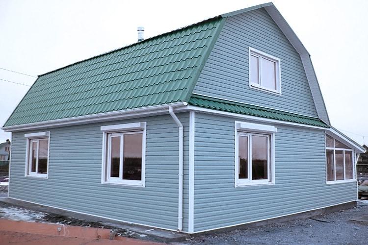 Обшивка фасада алюминиевым сайдингом - фото частного дома