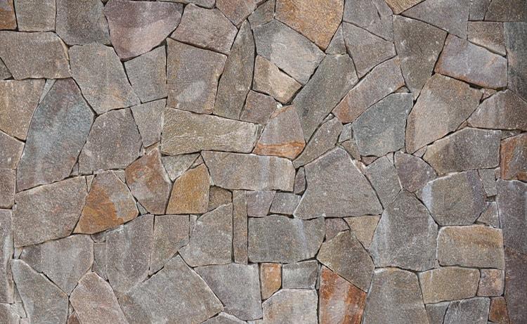 Облицовка фасада натуральным камнем - фото материала